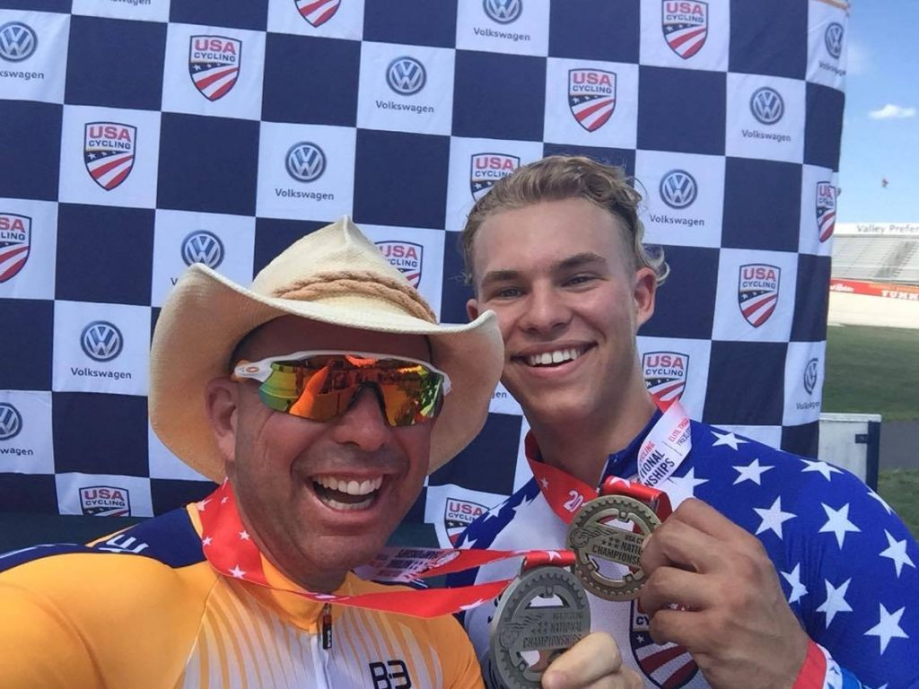 Karl Baumgart (left) and Dominic Suozzi celebrate their time trial medals at elite track nationals.